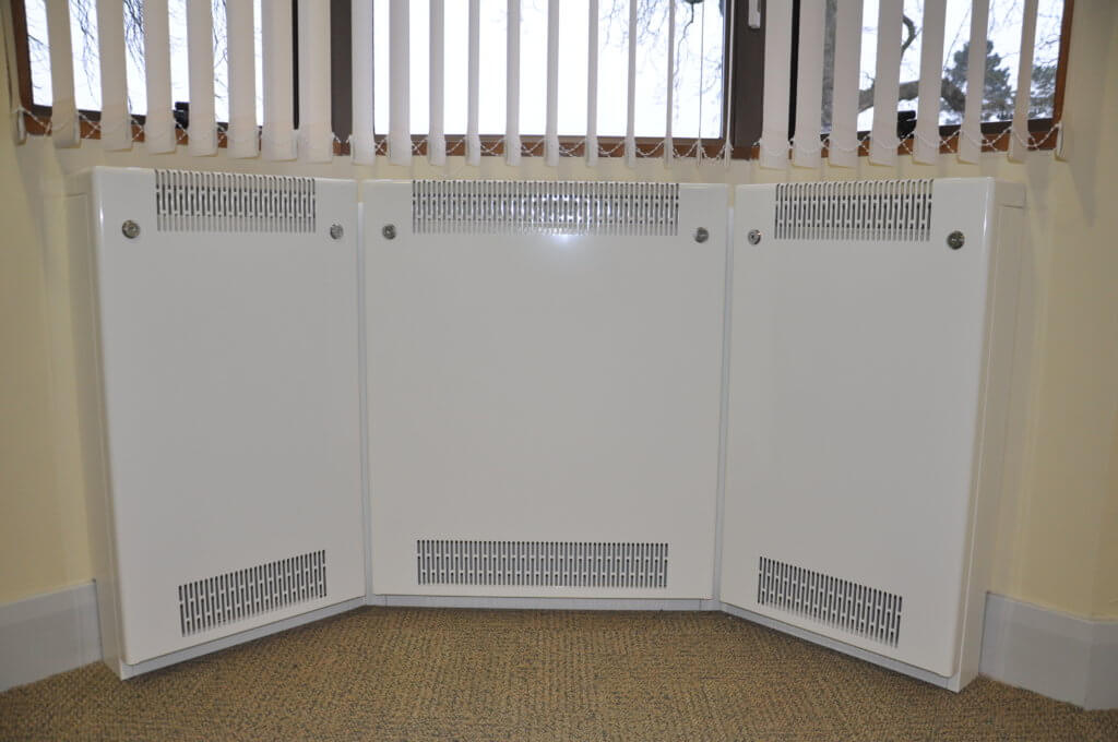 Bay window radiator covers allow a low surface temperature system to follow angled or contoured walls by way of an innovative internal fixing bracket